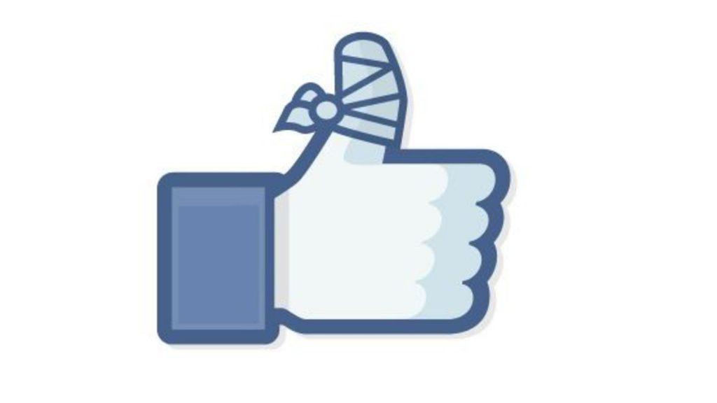 Pouce Like de Facebook avec un pansement